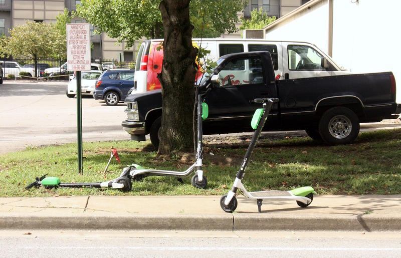 scooters on a sidewalk