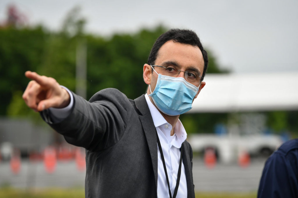 Dr. Alex Jahangir gestures while wearing a mask.