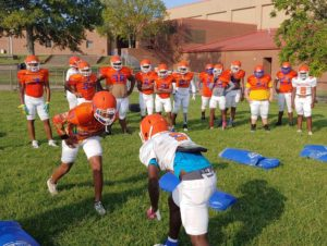 Football players at Hunters Lane High School square off on their first day of practice this fall.