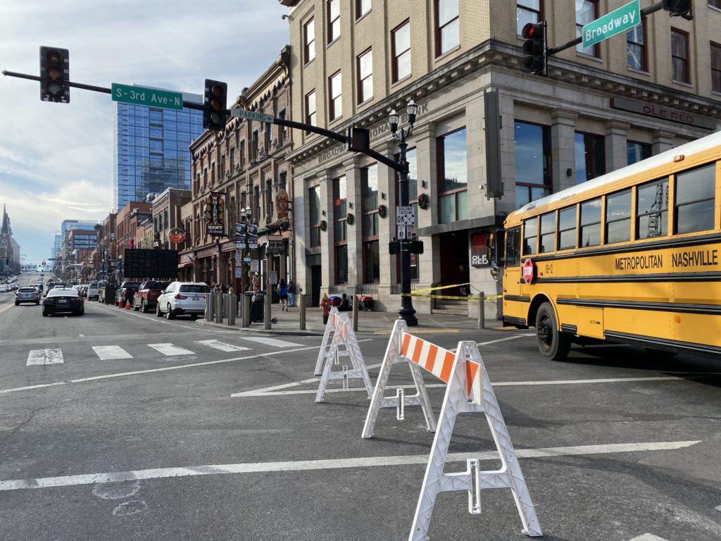 A school bus barricades Third Avenue at Broadway.