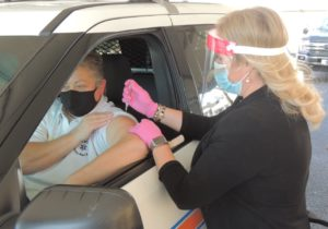 Dr. Lisa Piercey giving vaccination
